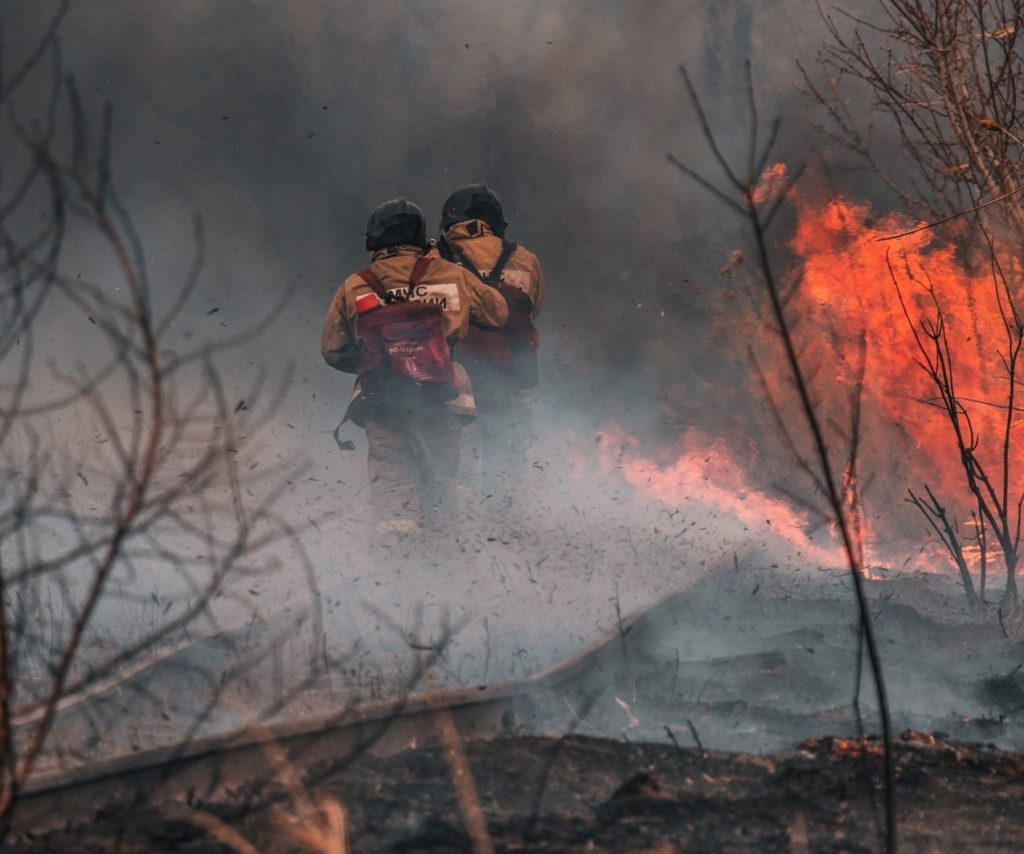 Fire Fighters Rush Into Burning Forest