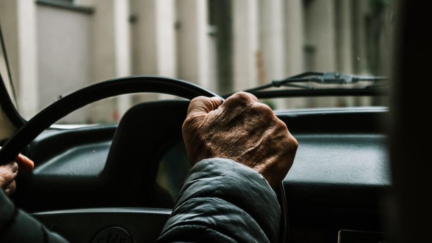 Man Of Older Age Has Hands on Steering Wheel