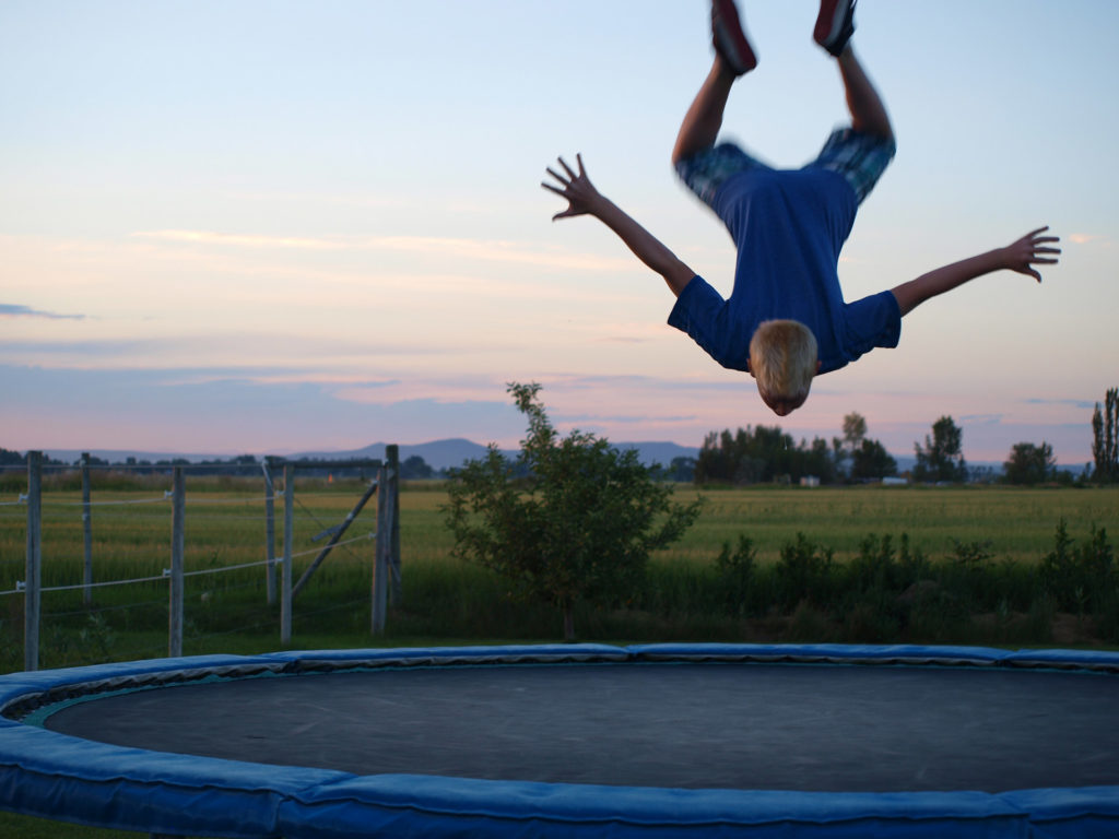 Kid Upside-Down on Trampoline