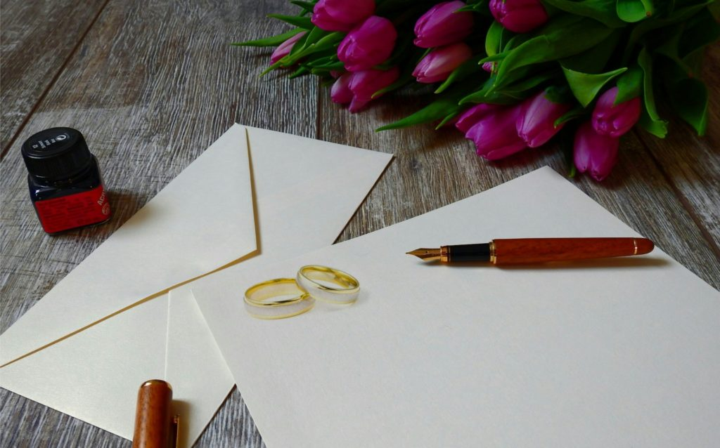 Wedding Card with Flowers on a Table
